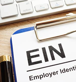 employer identification number (EIN) on clipboard paper.